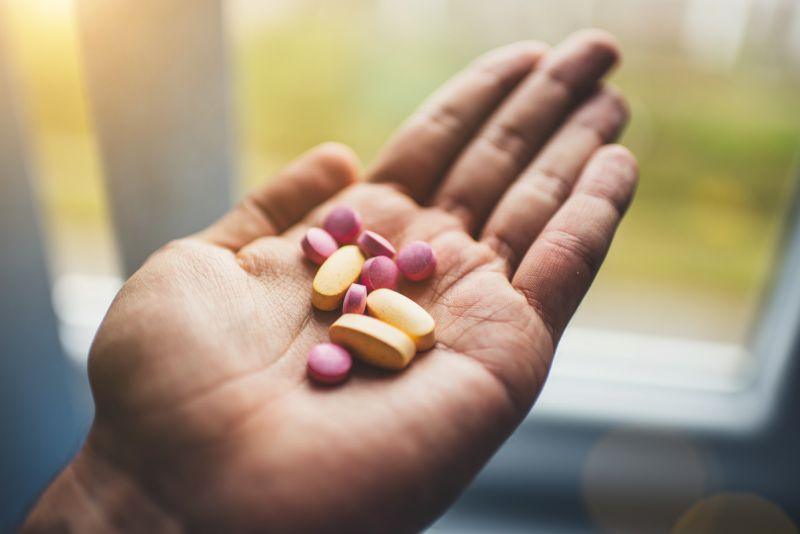 vitamins in hands